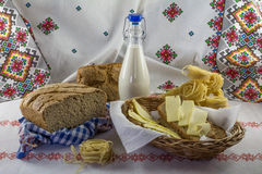 Food composition milk bottle, pasta and butter Stock Photography