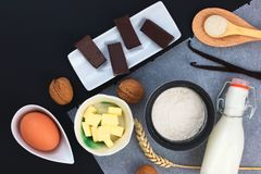 Food concept Bakery preparation by flour, egg, butter, sugar, chocolate, vanilla beans, walnuts and milk decor by wheat ear Royalty Free Stock Photo