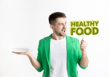 Food concept. Model holding a plate with letters of Healthy Food royalty free stock photo