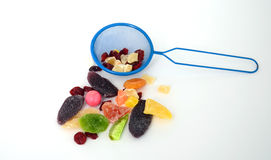 Food concept. Picture of a    blue tea strainer and dry fruits Stock Images