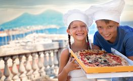 Food concept. Pizza. Cute kids holding pizza outdoors stock photography
