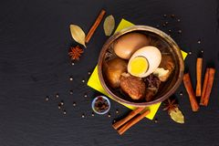 Food concept Thai cuisine Pork Belly and Egg with five spice Fragrant Stew Moo Palo on black slate board with copy space stock photo