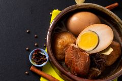 Food concept Thai cuisine Pork Belly and Egg with five spice Fragrant Stew Moo Palo on black slate board with copy space royalty free stock photo