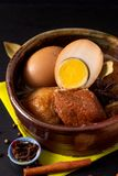 Food concept Thai cuisine Pork Belly and Egg with five spice Fragrant Stew Moo Palo on black slate board with copy space stock photography