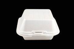 Food container. Small take-out food container isolated on a black background Royalty Free Stock Image