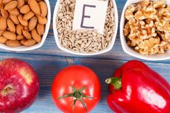 Food containing vitamin E, minerals and dietary fiber, healthy nutrition. Food and ingredients containing vitamin E, natural minerals and dietary fiber, healthy royalty free stock image
