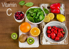 Food containing vitamin A. On a wooden background Royalty Free Stock Images