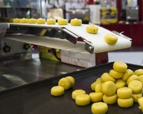 Food in conveyor. Of machine ; selective focus stock photo