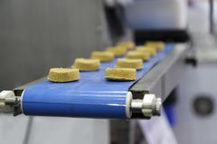 Food in conveyor. Of machine ; selective focus royalty free stock images