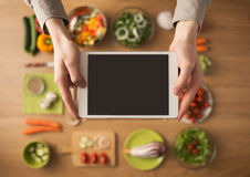 Food and cooking app on digital tablet Royalty Free Stock Image