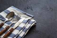 Food cooking background. Careless simple table setting. Set of cutlery with wooden handles. Food cooking background. Careless simple table setting. Set of Stock Photography