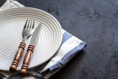 Food cooking background. Careless simple table setting. Set of cutlery with wooden handles. Food cooking background. Careless simple table setting. Set of Royalty Free Stock Photo