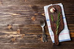 Food cooking background with wooden cutting board, cutlery and spices. Top view stock image