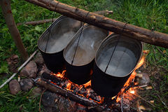 Food cooking on camp fire Royalty Free Stock Photography