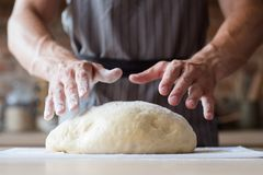 Food cook chef bread puff pastry man hands dough. Food cooking concept. chef preparing homemade bread or puff pastry. man hands ready to knead dough royalty free stock photo