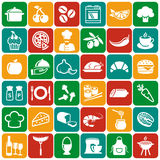 Food and cooking icons. Vector set. Food and cooking flat icons. Set of white symbols for a culinary theme. Healthy and junk food, fruit and vegetables, spices Royalty Free Stock Photography
