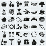 Food and cooking icons. Vector set. Food and cooking web icons. Set of black symbols for a culinary theme. Healthy and junk food, fruit and vegetables, spices stock illustration