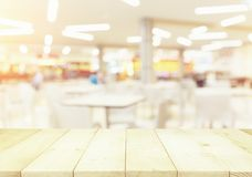 Food Court Blurred. Defocused or blurred photo of food court montage with wood table top use for background Stock Photos