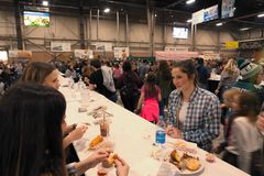 Food Court. Harrisburg, PA, USA - January 6, 2019: The Food Court, featuring fair-like food from Pennsylvania farms, is a crowd favorite at the 2019 Farm Show royalty free stock photo