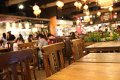 Food court in the mall. Dining tables in the food court royalty free stock photo