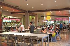 Food court. People eating fast food at the food court stock photo