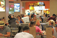 Food court. People eating fast food in food court Stock Image