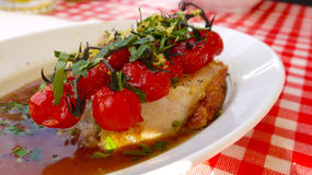 Luxurious starter with vine tomatoes Stock Photos