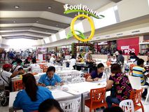 Food court at a shopping mall. ANTIPOLO CITY, PHILIPPINES - NOVEMBER 19, 2015: Food court at a shopping mall in Antipolo City, Philippines Royalty Free Stock Photo