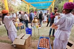 Food court with tea-masala stand and cooking Rajput men Royalty Free Stock Photos
