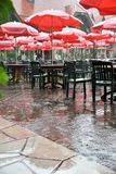 Empty tables during rain storm in St. Louise at Grand Farm. This food court was cleared by a rain storm at Grants Farm, it was a great time to get a table if you stock images