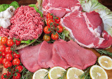 Food cousine composition ingredient for eating meat beef. Composition of beef, ground pork with rosemary and mushroom salad Stock Photography