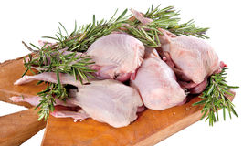 Food cousine composition ingredient for eating meat. Chicken composition and rosemary on the wooden cutting board Royalty Free Stock Photo