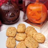 Food cousine production of typical Italian biscuits. Tuscan artisan biscuits used for parties sculptures made of chocolate to resemble a pumpkin for Halloween stock photos