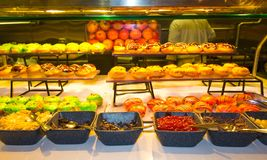 Food at a cruise ship. Dining Room Buffet aboard the abstract luxury cruise ship. Selective focus. Cakes Stock Image