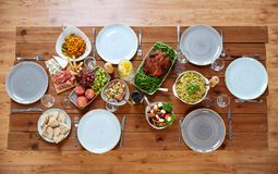 Various food on served wooden table Royalty Free Stock Images