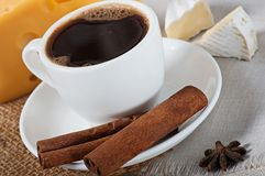 Food - a cup of fragrant hot coffee and a delicious cheese. Royalty Free Stock Images