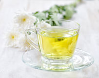 Cup of herbal tea and flowers Royalty Free Stock Photo