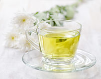 Cup of herbal tea and flowers Stock Photo