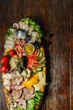 Food on dark wood background. Various snack. Stock Photos