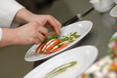 Food decoration. In a restaurant kitchen Stock Images