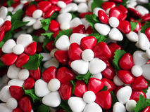 Food and decoration. Italian sugared almonds. Sugared almonds as petals for these floral creations colored painted with the color of the Italian flag stock photos