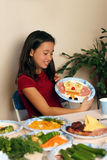 Food decoration party. Girl having fun with her food Royalty Free Stock Photography