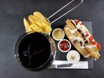 Food delicious elegant eat table beverage. Wine redwine chips fastfood cutlery blackplate blackbackground Stock Image