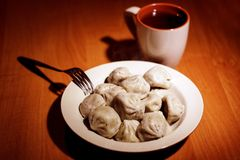 Food. Delicious khinkali with tea on the table Royalty Free Stock Photos