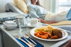 Food delivered to a patient in hospital bed. Focus on the meal royalty free stock image