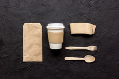 Food delivery with paper bags and plastic cup on dark table background top view mockup Royalty Free Stock Image