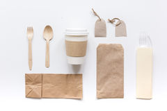 Food delivery with paper bags and plastic cup on gray table background top view mockup Royalty Free Stock Image