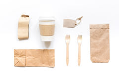 Food delivery with paper bags and plastic cup on gray table background top view mockup Stock Image