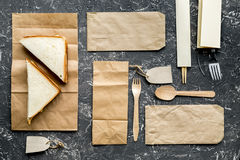 Food delivery with paper bags and sandwich on gray background top view. Food delivery service workdesk with paper bags and sandwich on gray background top view stock photography