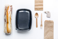 Food delivery with paper bags and sandwich white background top view mockup Stock Photo